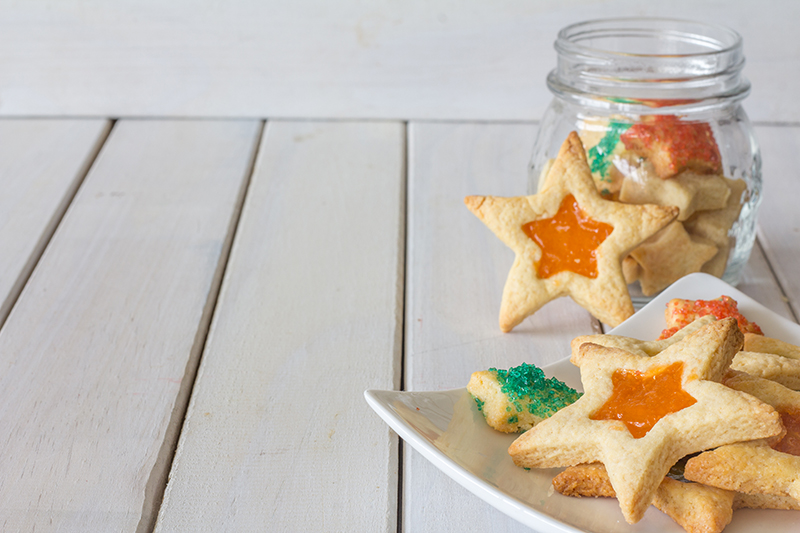 Stained Glass Christmas Star Cookies on a Plate and In a Jar Horizontal with Copy Space