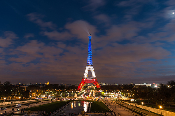 Mandatory Credit: Photo by REX Shutterstock (5398787b) The Eiffel Tower lit up in the red, white and blue of the French flag Tributes to the victims of the Paris terrorist attacks, Paris, France - 18 Nov 2015