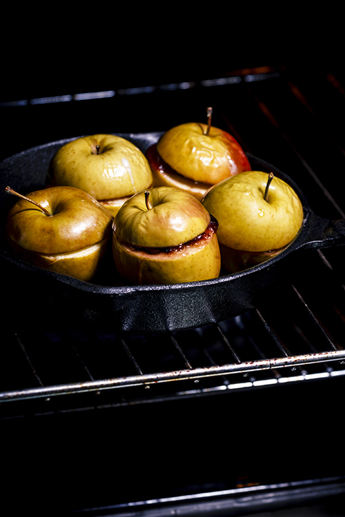 cooking baked apples with jam in oven