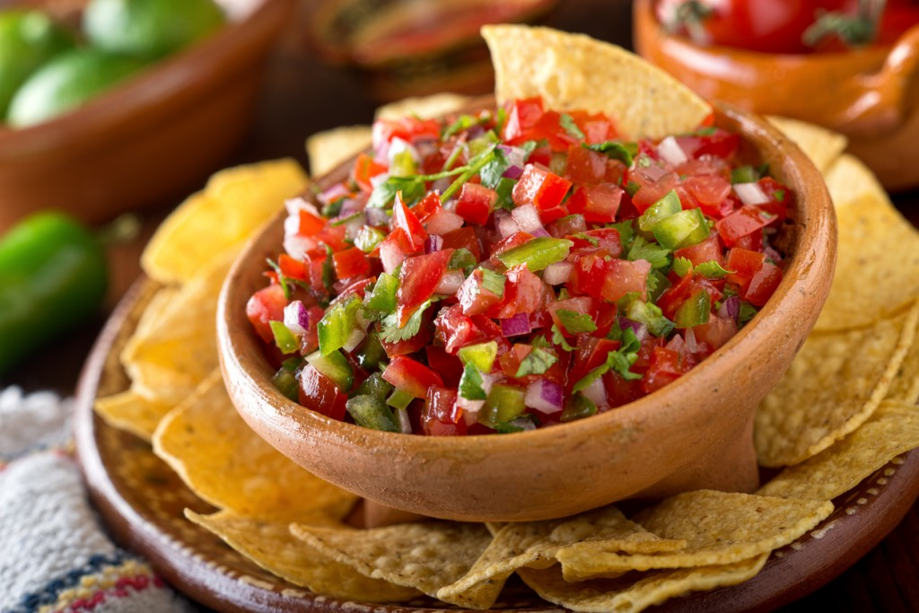 A delicious home made salsa pico de gallo with tomato, red onion, lime, cilantro, and jalapeno pepper.